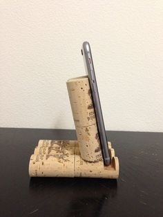 This is a wine cork iPhone stand. These are genuine corks that have been upcycled. This makes a great conversation piece. If you do not have an apple