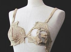 This is a 600-year-old bra, part of a recently-publicized archaeological find of thousands of 15th century textiles in an Austrian castle. Read more about it at http://www.historyextra.com/lingerie#