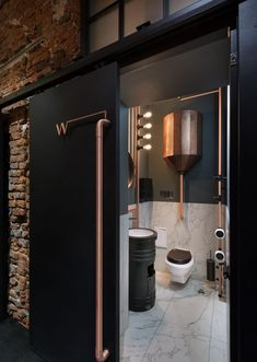 Labs Image 8 of 24 from gallery of Copper Head / YOD design lab. Photograph by Andrey Avdeenko - Image 8 of 24 from gallery of Copper Head / YOD design lab. Photograph by Andrey Avdeenko Industrial Bathroom, Industrial House, Industrial Interiors, Industrial Style, Vintage Industrial, Copper Bathroom, Industrial Wallpaper, Industrial Closet, Industrial Bookshelf