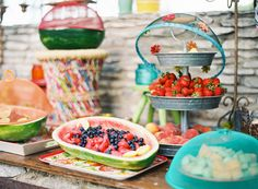 Picnic style wedding reception at a casual, colorful outdoor wedding.