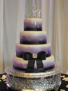bling wedding cake with purple, I personally do not like to topper but it is a beautiful cake