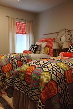 Colorful bedding in college dorm room