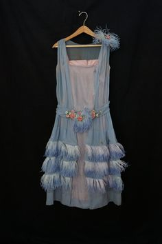 1920s dress with marabou feather and floral embellishments. Ebayseller: danevintage