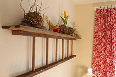 I remember using a standing wood ladder as a bookshelf long ago, this is cute too...maybe pic frames in between rungs?