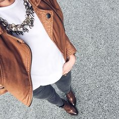 Gray jeans and brown leather jacket