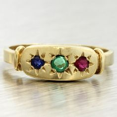 Antique Victorian 1900s 14k Solid Yellow Gold Emerald Ruby & Sapphire Gypsy Ring. This ring is a size 6.5 and is also re-sizable. Please contact us for