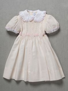 Philadelphia Museum of Art - Collections Object : Girl's Dress and Ribbon Belt 1960s-70s  Medium: Ivory wool crepe smocked in pink and ivory cotton thread, white cotton plain weave, pink silk/synthetic velvet ribbon