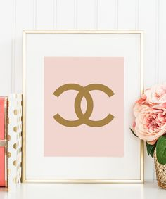"""Fun Coco Chanel CC print in blush and gold to brighten up your living room wall. This adorable fashion print is what your walls desperately need! - Available in size 8""""x10"""" - Digitally printed with ri"""