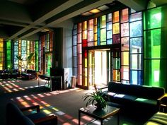 """Stained glass in the Ethical Society of St. Louis (in Ladue, MO) -- """"Light streaming into the main entry hall shines through the abstract, yet sensual colors of the stained glass [Harris] Armstrong selected for this south-facing space."""