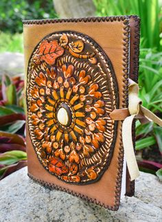 This beautiful book cover is made from the highest quality Thai leather. Every inch of this book was made by hand, and took an entire day to finish. This book cover is truly one of a kind since we make no design twice. Find out more information on our Etsy Store: https://www.etsy.com/shop/LannaCafeOrganics