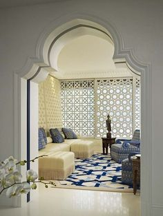 Rich Moroccan living room in subtle colors and light blue