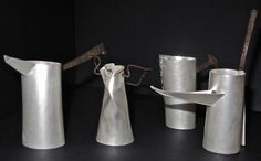 Ali Stringell - jugs - fine silver, rusted old nails