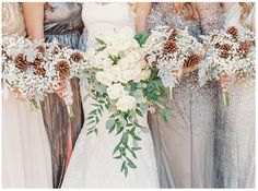 Classic waterfall bouquet with white flowers and hanging greenery, but I'm not a fan of the pinecone bouquets.