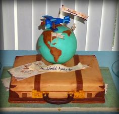 """The World Awaits You"" vintage suitcase cake and globe cake pops"