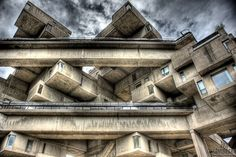 Habitat 67 is a housing complex and landmark located on the Marc-Drouin Quay on the Saint Lawrence River in Montreal, Quebec, Canada. Its design was created by architect Moshe Safdie based on his master's thesis at McGill University and built as part of Expo 67.