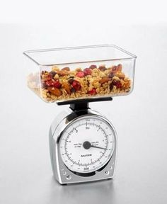 "Salter 051 Chrome Mechanical Kitchen Scale by Salter. $18.41. Scale fits inside the weighing container for compact storage. Tare knob. Large, 6.9"" x 5"" x 2.9"" weighing container. Dual reading dial. 1kg / 2lb capacity x 10g / 0.5oz resolution. 10 year manufacturer's warranty. Measures up to 2 lbsFine 1/2 oz incrementsDishwasher safe bowlScale fits inside bowl for neat storage10 Year WarrantyNo assembly requiredOverall dimensions: 5.38 in. L x 4.25 in. W x 7.25 in. H (1.5 lbs)Co..."
