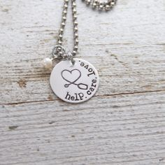 help. care. love. medical necklace.  Great for a nurse or doctor gift, but I have a friend with special needs kiddos...this would be perfect for her!  Only $28
