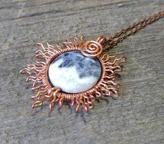 Handcrafted wire wrapped, Copper Wire Sun, Eclipsed by a Blue Sodalite Moon. ***while we do use a tarnish resistant coated copper wire we do not guarantee it not to tarnish*** Includes a 18 Antique copper chain with Lobster claw clasp.