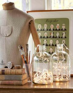 Light Up a Jug  From empty jars to illuminating conversation pieces: Fill a glass jug with Christmas lights to fashion a tricked-out table lamp.