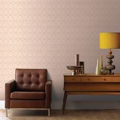The Superfresco Damask Beige Wallpaper has a small scale damask design that will add a touch of classical charm to any wall. This quality expanded vinyl wallpaper product is even thick enough to cover minor imperfections in your wall.Click to shop for yours.