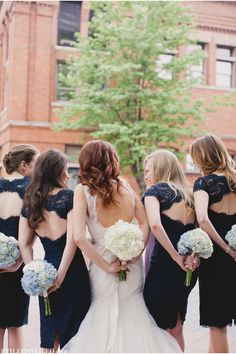 Bridesmaids dressed in midnight blue I would change the color to blush or cream!