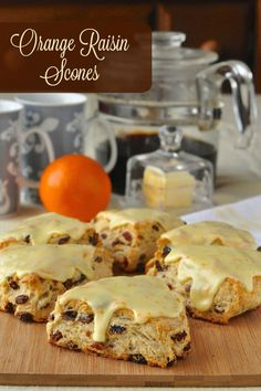 Orange Raisin Scones with Orange Glaze - tender English style scones infused with orange flavour and packed with raisins before being topped with a sweet but tangy orange glaze.