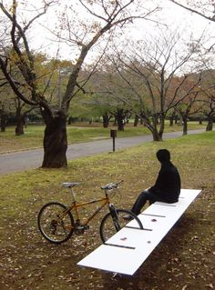 Love this simple bike park/bench No fear of your #bike getting scratched up against a tree while you have lunch at the park.