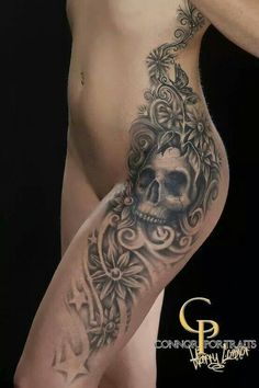 Skull and flowers tattoo. Hip and full side placement.