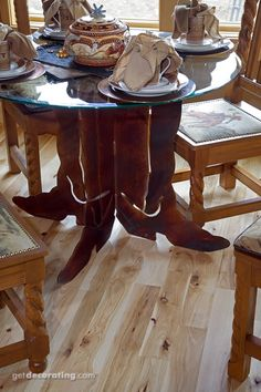 Darling if you have a western decor.love this table! the cowboy boots are awesome!!