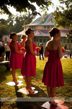 Plywood hearts for bridesmaids to stand on = no heels stuck in the dirt -- great idea for an outdoor wedding!
