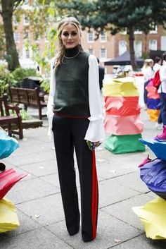 For a London Fashion Week presentation, Olivia layered up as only Olivia knows how, adding a smart twist to her Zara trousers.