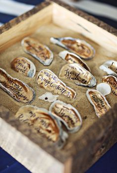 Whether you're tying the knot just steps from the ocean or simply have a deep love of all things nautical, there are a lot of beach-inspired details that you can add to your wedding that will feel thematic, but won't leave your day feeling themed Juliet Grace Design penned names onto these gold painted oyster shells for a chic and beachy escort card.