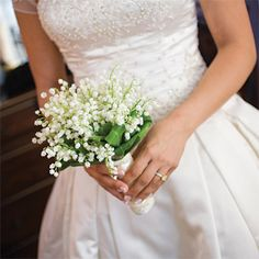Brides: Lily of the Valley Wedding Nosegay. Marina carried a classic lily-of-the-valley nosegay.