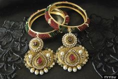 This set of Jewellery comprising mixture of fine quaity metal has one pair of Traditional Multicolour Earrings & Gold Plated Bangles