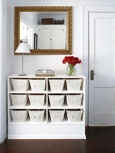 Storage space is so important in a dorm room, or any small space. Here an old dresser is painted with no drawer fronts. Baskets are used instead.