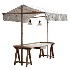 Vintage Garden Table, circa France 1920s.  i love that the structure for the awning and lights is built in - and could probably be made to anchor the whole structure more firmly to the ground. very do-able.