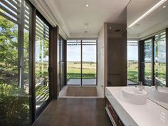 Master ensuite designed by B.E Architecture opens to the country views