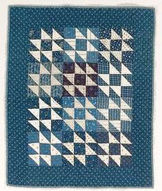Blue and white vintage doll quilt.