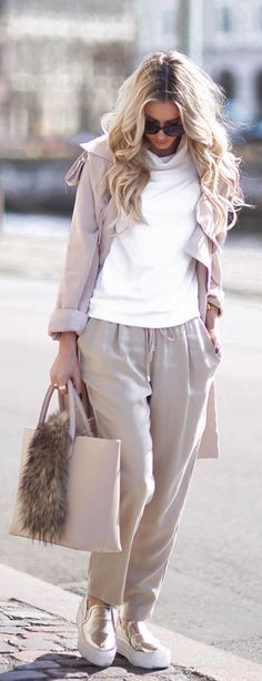 Athleisure Fashion Trend: Sendi Skopljack is wearing a blush pink Clean State trench coat with Karen Kane drawstring trousers and gold Forever 21 pumps