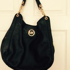 Michael Kors Bag Black soft leather, no stains no tears in good condition gold hardware in good condition.comes w/dust bag Michael Kors Bags Shoulder Bags