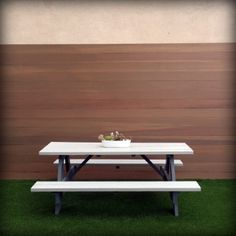 A custom wood wall, backyard table bench, and beautiful synthetic turf. http://www.trulandscape.com