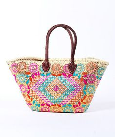 Natural & Pink Sapelo Island Shopping Tote by Found Object  Whether headed to the local farmers market or off to a picnic, carry all essentials in this stylish tote. Durably woven from palm leaves, it features a spacious interior and stunning, sequin-adorned embroidery.