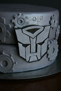 Transformer cake - All decorations are MMF and gumpaste. The allspark cube that the optimus toy was holding is rice krispy treat covered in MMF.