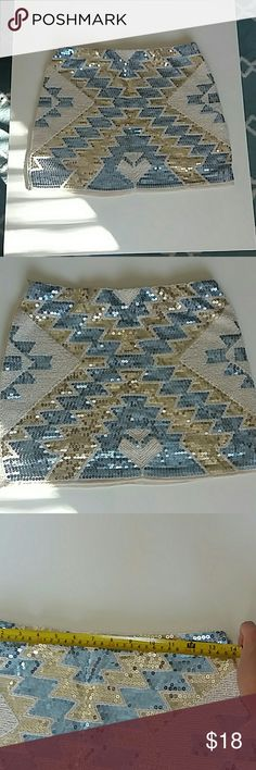 Stunning Aztec Sky Blue and Gold Sequin Mini Skirt Bought it online, but it is too big on me. Size S but seems to run larger.  Measures 14'' in the waist and 18'' in the hip.  Probably best for size 4- 6.  Never worn.   Not forever 21. Listed as such for exposure.  Cheaper on Ⓜercari. Ask if interested Forever 21 Skirts Mini