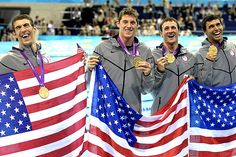 Michael Phelps, Conor Dwyer, Ricky Berens and Ryan Lochte pose with their gold medals