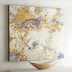 A fantastical impression of a golden sky, our abstract artwork layers shimmering gold atop fluffy white clouds and an azure blue sky. A sublime statement piece, it works wonderfully when hung over a sofa or atop your mantel.