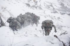 February 19: Soldiers attending the US Army Mountain Warfare School in Jericho, Vermont, climb Smugglers' Notch as part of their final phase of the Basic Military Mountaineering Course in Jeffersonville, Vermont. Students in the course spend two weeks acquiring the skills and knowledge required to operate in mountainous terrain.