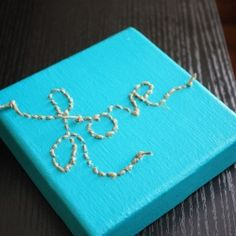 A simple tutorial on making a plain old canvas into a simple but meaningful decorative object for your home.