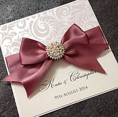 Gorgeous invitation made by Chosen Touches.  Pearl embellishment with satin bow details.  Flocked paper.