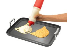 Get the kids involved in breakfast making or show your artistic side with this unique pancake creator. Measure and mix your batter right in the dispenser and start creating fun shapes at your next breakfast! Features an interchangeable heat-resistant nozzle to control batter flow and the sturdy plastic container can hold up to 2 cups of any brand of pancake mix, making up to 14 pancakes. The plastic cap also works as a liquid measuring cup.